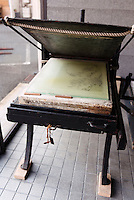 An old printing press in the entrance of Benrido collotype atelier, Kyoto, Japan, October 9, 2015. The Benrido collotype atelier in Kyoto was founded in 1887 and is the only full-scale commercial collotype atelier in the world. Collotype is a historic photographic printing process that makes use of plates coated in gelatine. It produces prints of unrivalled quality.