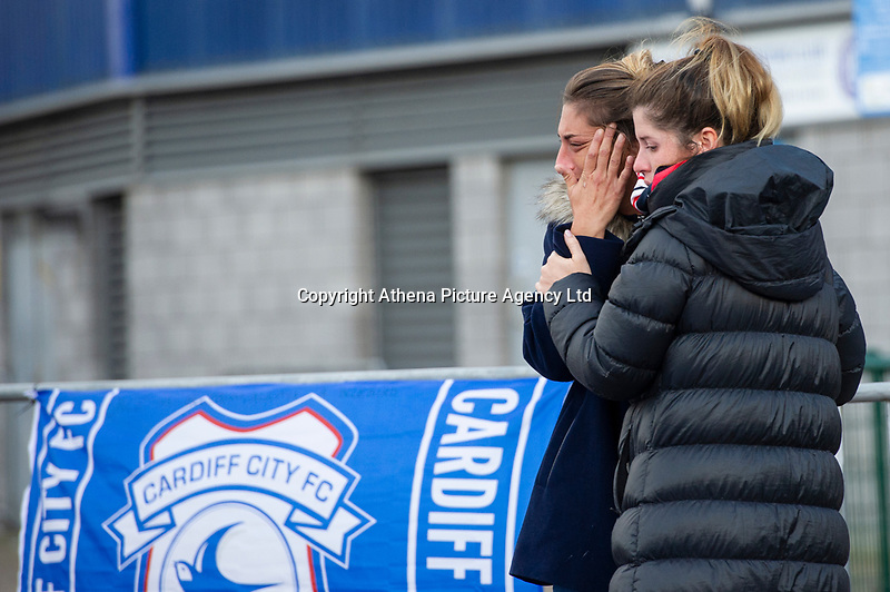 Pictured: Sala's sister Romina Sala (left) pays tribute for Emiliano Sala laid down outside the Cardiff City Stadium in south Wales, UK. Friday 25 January 2019<br /> Re: Premier League footballer Emiliano Sala was on a flight which disappeared between France and Cardiff.<br /> The Argentine striker was one of two people on board the Piper Malibu, which disappeared off Alderney on Monday night.<br /> Cardiff City FC, signed the 28-year-old from French club Nantes.