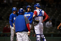 Rancho Cucamonga Quakes first baseman Cristian Santana (5) and Stockton Ports catcher Jonah Heim (13) exchange words after Santana's home run during a California League game against the Stockton Ports at Banner Island Ballpark on May 16, 2018 in Stockton, California. Rancho Cucamonga defeated Stockton 6-3. (Zachary Lucy/Four Seam Images)