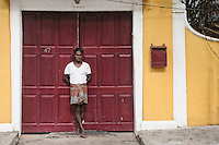 An Indian man standing in front of a building in the French colony in Pondicherry.Arindam Mukherjee/Sipa