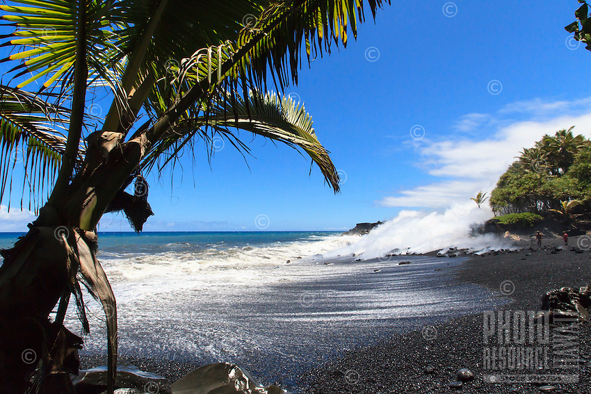 Spectators observe lava from the Kilauea volcano entering the ocean at Fox's Landing black sand beach on the Big Island.