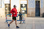 A man runs during the first day of liftning of the confinement restrictions in Caceres, Extremadura. 02 May 2020(Alterphotos/Francis Gonzalez)