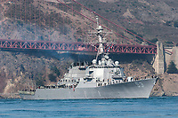 """The USS John Paul Jones (DDG-53) passes under the southern span of the Golden Gate Bridge during the Parade of Ships as part of the 2006 San Francisco Fleet Week activities. The USS John Paul Jones (DDG-53) was commissioned on December 18, 1993 as the third Arleigh Burke guided missile destroyer, and is homeported in San Diego, California. The ship is named in honor of Naval hero, John Paul Jones, and derives her motto, """"In Harms Way,"""" from a famous quote of his, """"I wish to have no connection with any ship that does not sail fast, for I intend to go in harm's way.""""  Photographed 10/06"""