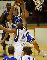 Brendon Polybank tries to shoot past George Baker during the NBL Round 14 basketball match between the Wellington Saints and Auckland Stars at TSB Bank Arena, Wellington, New Zealand on Thursday 29 May 2008. Photo: Dave Lintott / lintottphoto.co.nz