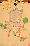 Home bulletin board with childs drawing of a happy family life