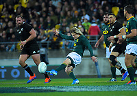 Faf de Klerk kicks during the Rugby Championship rugby union match between the New Zealand All Blacks and South Africa Springboks at Westpac Stadium in Wellington, New Zealand on Saturday, 27 July 2019. Photo: Dave Lintott / lintottphoto.co.nz