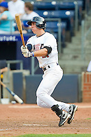 Michael Lorenzen #21 (Cal State Fullerton) of the USA Baseball Collegiate National Team follows through on his swing against the Japan Collegiate National Team at the Durham Bulls Athletic Park on July 3, 2011 in Durham, North Carolina.  USA defeated Japan 7-6.  (Brian Westerholt / Four Seam Images)
