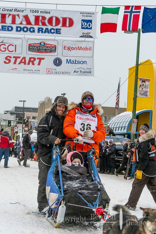 Aaron Peck and team leave the ceremonial start line with an Iditarider and handler at 4th Avenue and D street in downtown Anchorage, Alaska on Saturday March 7th during the 2020 Iditarod race. Photo copyright by Cathy Hart Photography.com