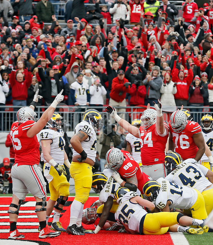 Ohio State Buckeyes running back Ezekiel Elliott (15) scores a rushing touchdown against Michigan Wolverines in the 3rd quarter of their game at Ohio Stadium in Columbus, Ohio on November 29, 2014.  (Dispatch photo by Kyle Robertson)
