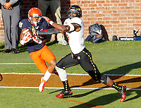 Virginia Cavaliers wide receiver E.J. Scott (19) makes a touchdown catch next to Maryland Terrapins linebacker Kenneth Tate (6) during the game in Charlottesville, Va. Maryland defeated Virginia 27-20.