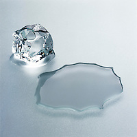 ICE CUBE MELTING <br /> Next to Puddle of Water<br /> (Variations Available)