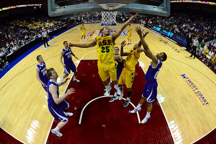 March 1, 2012; Las Vegas, NV, USA; San Francisco Dons forward Cole Dickerson (25) grabs a rebound against the Portland Pilots during the WCC Basketball Championships at Orleans Arena.