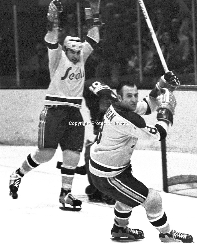 Seals score against the Maple Leafs, Gary Croteau and Gerry Ehman. (1970 photo by Ron Riesterer)