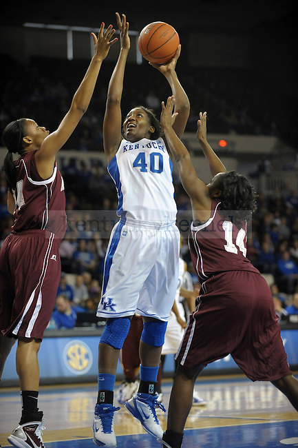 UK's Brittany Henderson shoots the ball while being double teamed during the first half of the University of Kentucky Women's basketball game against Alabama A&M at Memorial Coliseum in Lexington, Ky., on 12/18/10. Uk led at half 42-20. Photo by Mike Weaver | Staff