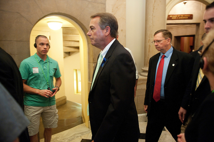UNITED STATES - JULY 25: Speaker of the House John Boehner, R-Ohio, wades through tour groups as he leaves a meeting with House Republican leaders in his office on Monday, July 25, 2011. (Photo By Bill Clark/Roll Call)