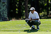 United States President Barack Obama lines up a putt on the first green at the Farm Neck Golf Club in Oak Bluffs, Massachusetts, U.S., on Saturday, August 9, 2014.  The President arrived on the island today and is vacationing for two weeks.  <br /> Credit: Matthew Healey / Pool via CNP