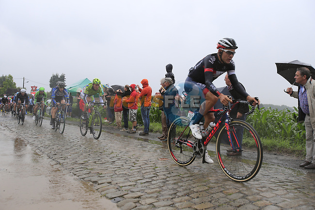 Riders including Heinrich Haussler (AUS) IAM Cycling tackle the1st cobbled sector 9 from Gruson to Crossroads de l'Arbe during Stage 5 of the 2014 Tour de France running 155.5km from Ypres to Arenberg. 9th July 2014.<br /> Picture: Eoin Clarke www.newsfile.ie