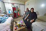 A couple in their modular home in a camp for internally displaced families in Ankawa, near Erbil, Iraq. Residents of the camp, mostly Christians, were displaced from Mosul, Qaraqosh and other communities in Iraq when ISIS swept through the area in 2014.