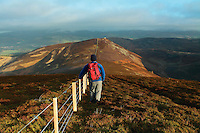 A walker descending Preston Law towards Newby Kipps which is part of the Glensax Horseshoe near Peebles in the Scottish Borders<br /> <br /> Copyright www.scottishhorizons.co.uk/Keith Fergus 2011 All Rights Reserved