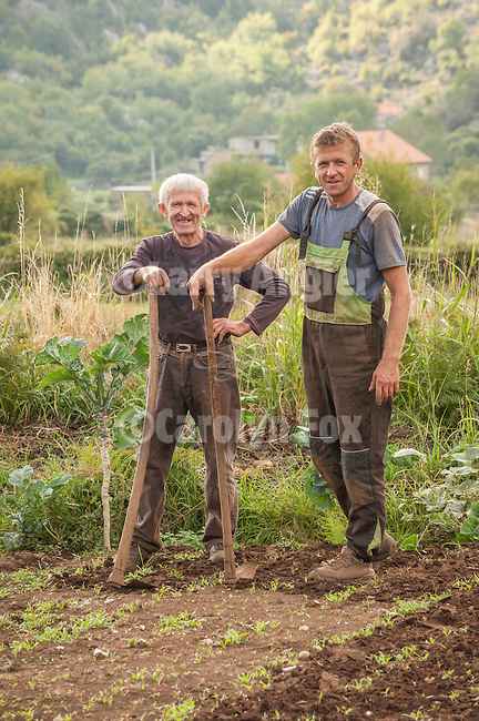 A father and son hoe their field in Krusevice, home town of the family of Fr. Sebastian Dabovich before they immigrated to the U.S. in the 1860s.