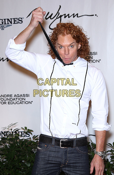 Carrot Top.2011 Andre Agassi Grand Slam for Children at The Wynn, Las Vegas, Nevada, USA..29th October 2011.half length jeans denim white shirt black tie hand arm choking strangling gesture funny .CAP/ADM/MJT.© MJT/AdMedia/Capital Pictures.