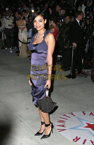 ROSARIO DAWSON.2005 Vanity Fair Oscar Party held at Morton's Restaurant. West Hollywood, CA.February 27th, 2005.Photo Credit: Jacqui Wong/AdMedia.full length purple silk satin dress black purse bag.www.capitalpictures.com.sales@capitalpictures.com.© Capital Pictures.