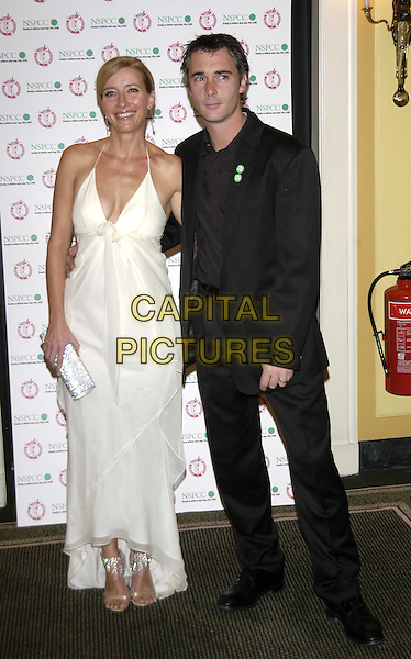 EMMA THOMPSON & GREG WISE.Awards of the London Film Critics' Circle ( ALF ).Best British Actress in a supporting role.11 February 2004.full length, full-length, award winner, long white dress.www.capitalpictures.com.sales@capitalpictures.com.©Capital Pictures