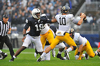 21 September 2013:  Penn State DE Deion Barnes (18) chases Kent State QB Colin Reardon (10). The Penn State Nittany Lions defeated the Kent State Golden Flashes 34-0 at Beaver Stadium in State College, PA.