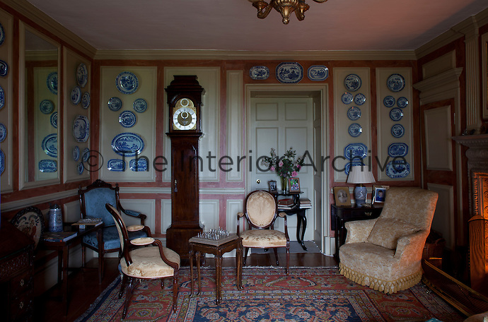 A blue and white china plate display on the drawing room wall