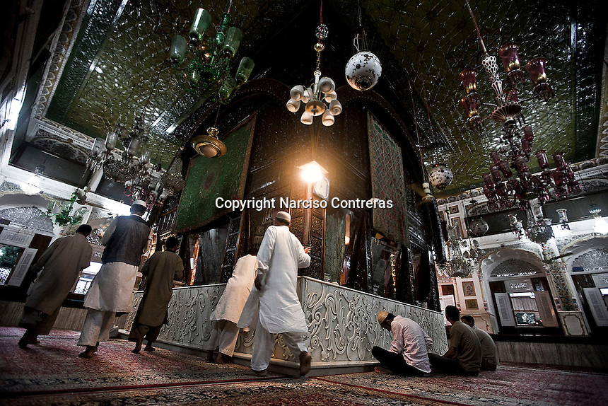 Kashmri muslim men praying at a shrine of a sufi saint in Srinagar as the main duty to observe the holy month of Ramadan. As the tradition is attended muslims has to fast from dawn to dusk, where they refrain from eating, drinking and smoking..