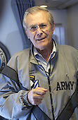 United States Secretary of Defense Donald H. Rumsfeld answers questions from reporters traveling with him to Andrews Air Force Base, Maryland, on September 8, 2003.  Rumsfeld is returning to the U.S. after a six-day trip to Iraq and Afghanistan. <br /> Mandatory Credit: Andy Dunaway / DoD via CNP