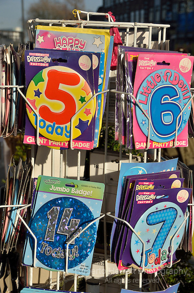 Birthday party badges on sale outside a shop
