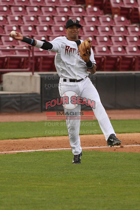 Wisconsin Timber Rattlers third baseman Sthervin Matos (9) throws to first base during a game against the Cedar Rapids Kernels on May 4th, 2015 at Fox Cities Stadium in Appleton, Wisconsin.  Cedar Rapids defeated Wisconsin 9-3.  (Brad Krause/Four Seam Images)