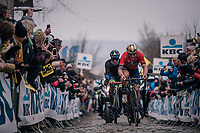Ivan Garcia Cortina (ESP/Bahrain-Merida) & Tom Devriendt (BEL/Wanty-Groupe Gobert) leading coming over the Oude Kwaremont cobbles<br /> <br /> 102nd Ronde van Vlaanderen 2018 (1.UWT)<br /> Antwerpen - Oudenaarde (BEL): 265km