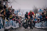 Ivan Garcia Cortina (ESP/Bahrain-Merida) &amp; Tom Devriendt (BEL/Wanty-Groupe Gobert) leading coming over the Oude Kwaremont cobbles<br /> <br /> 102nd Ronde van Vlaanderen 2018 (1.UWT)<br /> Antwerpen - Oudenaarde (BEL): 265km