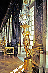 Crystal Chandeliers And Golden Statues In Mirror Room In Versailles