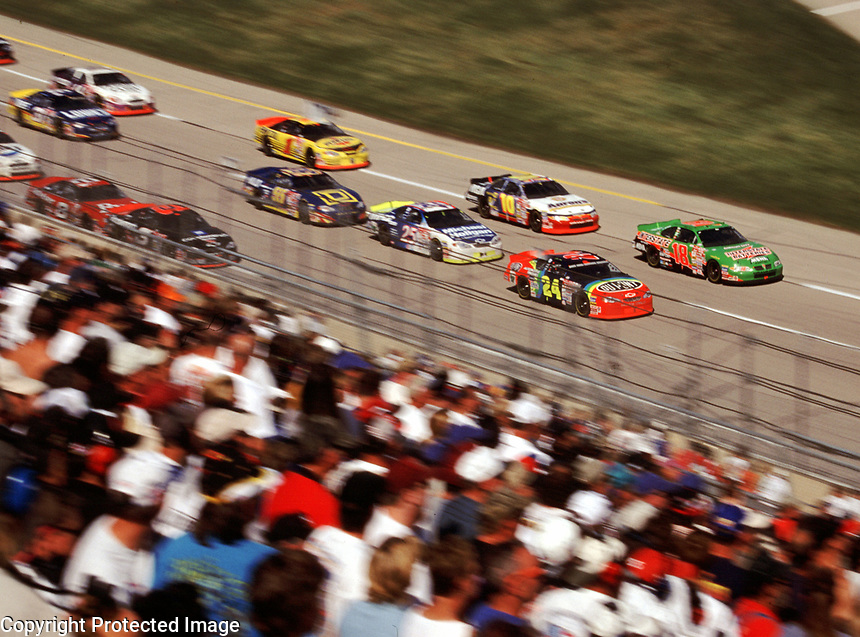Bobby Labonte and Jeff Gordon lead a pack of cars down the frontstretch during  the Winston 500 at Talladega, AL in October 2000. (Photo by Brian Cleary)