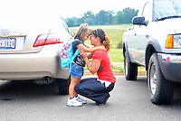 Grace Henriquez has a chat with her 5 year old daughter Janeliz after picking her up after her first day of school at Brumfeld Elementary School in Warrenton, VA on Monday.