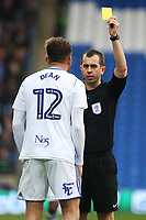 Harlee Dean of Birmingham City receives a yellow card from Referee Peter Bankes during the Sky Bet Championship match between Cardiff City and Birmingham City at the Cardiff City Stadium, Wales, UK. Saturday 10 March 2018