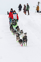 Ryan Redington on Cordova St. hill during the Anchorage start day of  Iditarod 2018<br /> <br /> Photo by Trent Grasse /SchultzPhoto.com  (C) 2018  ALL RIGHTS RESERVED