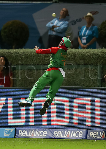 13.03.2015. Hamilton, New Zealand.  Bangladesh's Sabbir Rahman attempts a catch on the boundary during the ICC Cricket World Cup match - New Zealand v Bangladesh played at Seddon Park, Hamilton, New Zealand on Friday 13 March 2015.