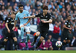 Ilkay Gundogan of Manchester City and Ki Sung Yueng of Swansea City during the premier league match at the Etihad Stadium, Manchester. Picture date 22nd April 2018. Picture credit should read: Simon Bellis/Sportimage