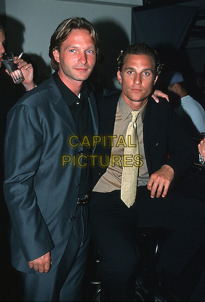 "THOMAS KRETSCHMANN & MATTHEW McCONAUGHEY.German film premiere of ""U-571""..September 8th, 2000.half length blue black suit jacket beige yellow tie .CAP/PPG/TR.©Tom River/People Picture/Capital Pictures"
