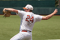Texas Longhorns starting pitcher Parker French (24) warms up during a delay of the NCAA Super Regional baseball game against the Houston Cougars on June 7, 2014 at UFCU Disch–Falk Field in Austin, Texas. The Longhorns are headed to the College World Series after they defeated the Cougars 4-0 in Game 2 of the NCAA Super Regional. (Andrew Woolley/Four Seam Images)