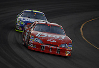 Apr 22, 2006; Phoenix, AZ, USA; Nascar Nextel Cup driver Dale Earnhardt Jr. of the (8) Budweiser Chevrolet Monte Carlo leads Jimmy Johnson during the Subway Fresh 500 at Phoenix International Raceway. Mandatory Credit: Mark J. Rebilas-US PRESSWIRE Copyright © 2006 Mark J. Rebilas..