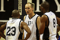 Giants guard Phill Jones talks to Jarryd Lloyd and Nico Ritschny during the NBL Round 2 basketball match between the Wellington Saints and Nelson Giants at TSB Bank Arena, Wellington, New Zealand on Thursday 19 March 2009. Photo: Dave Lintott / lintottphoto.co.nz