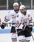 Mike Hewkin (NU - 28), Greg Costa (NU - 22) - The Northeastern University Huskies defeated the Boston College Eagles 3-2 on Friday, February 19, 2010, at Matthews Arena in Boston, Massachusetts.