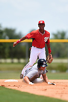 GCL Nationals second baseman Thomas Alvarez (4) watches his throw attempting to turn a double play during a game against the GCL Marlins on June 28, 2014 at the Carl Barger Training Complex in Viera, Florida.  GCL Nationals defeated the GCL Marlins 5-0.  (Mike Janes/Four Seam Images)