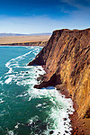 The cliffs of Playa Yumaque in the Paracas National Reserve, a subtropical coastal desert in Peru.