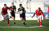 New Zealand number 8 Liukanasi Manu attacks the Welsh line during the Division A clash at Ravenhill. Result New Zealand 37 Wales 14.